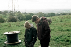 selfish-giant-the-2013-006-kids-on-hillside-with-pylon-wire